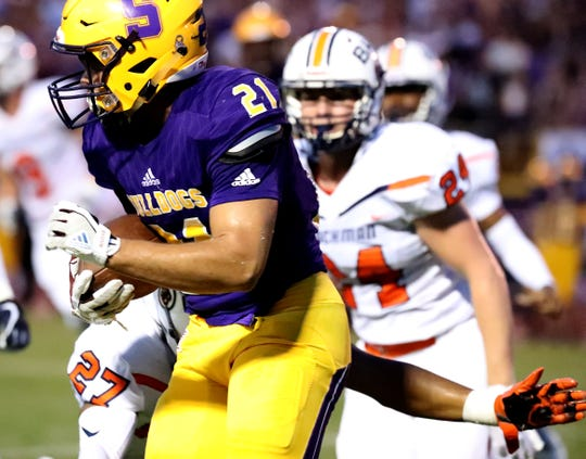 Smyrna's Blake Watkins (21) runs the ball as Blackman's Jalen Brown (27) moves in for a tackle during the game at Smyrna High School on Friday, Sept. 7, 2018.