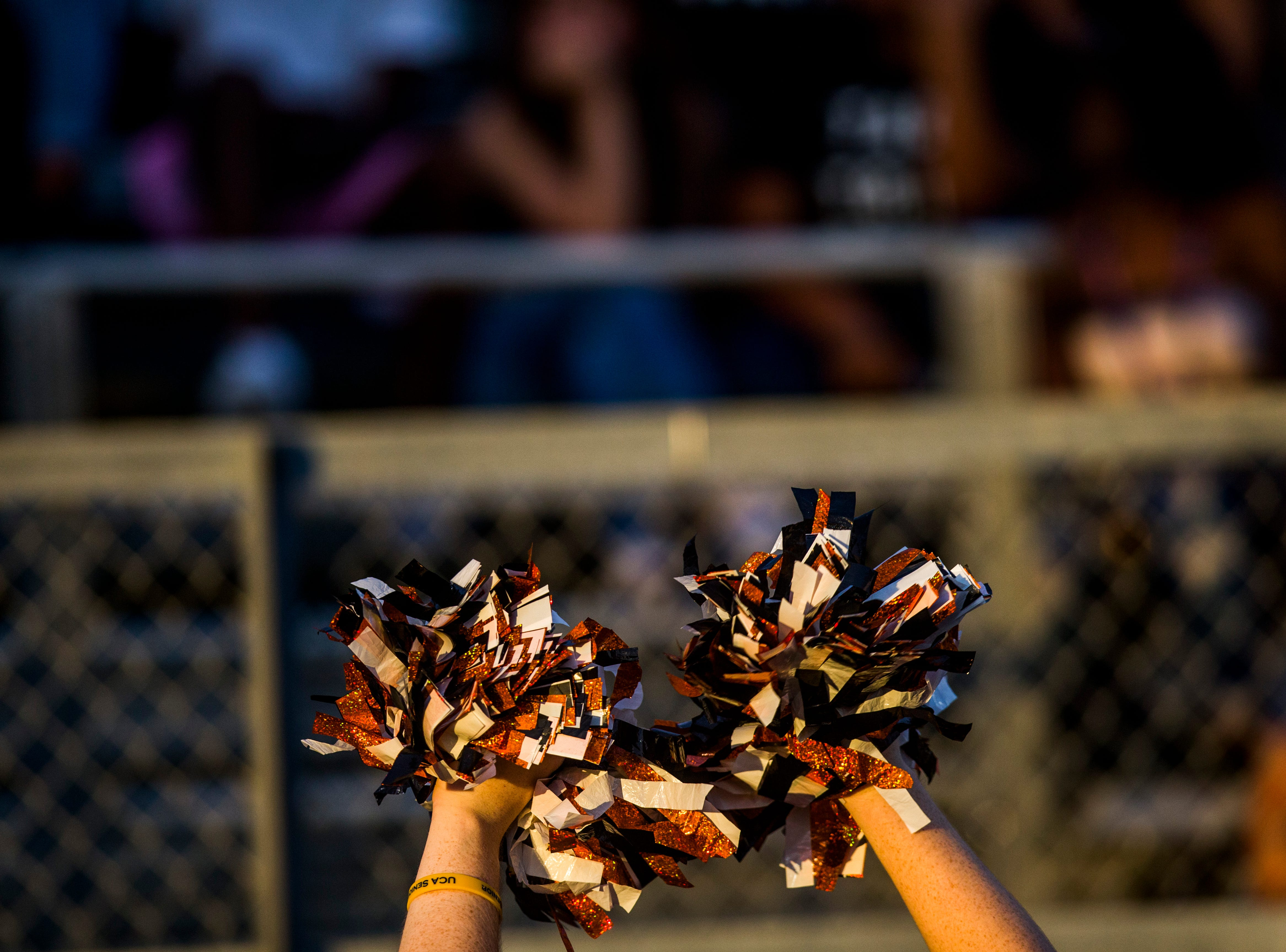 Lely cheerleaders lead cheers on the sidelines during the game against Golden Gate at Lely High School on Friday, Sept. 7, 2018.