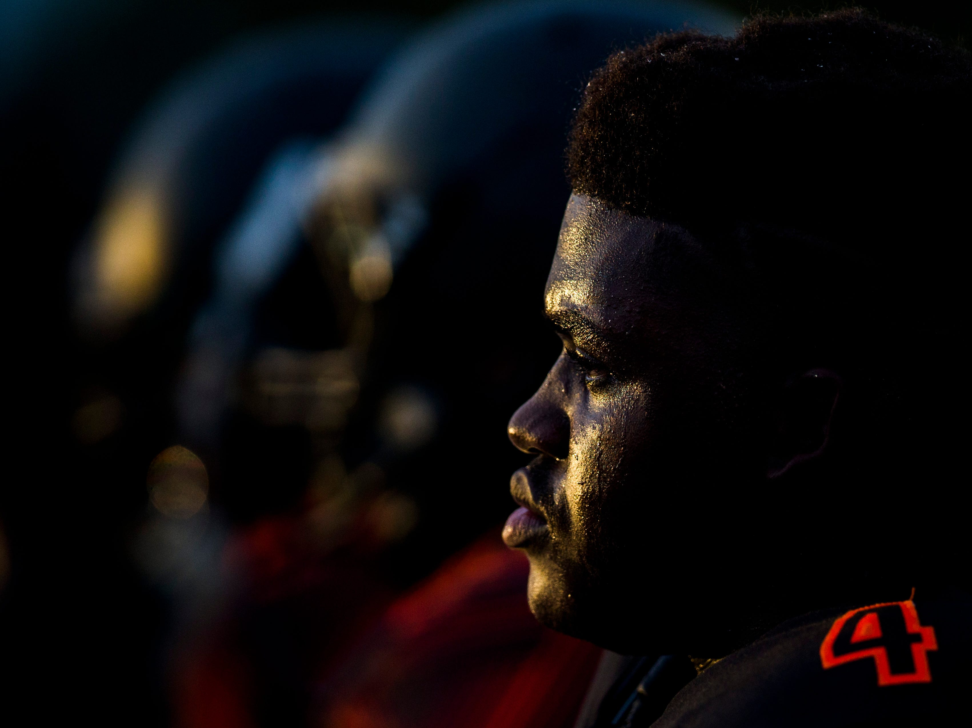 Lely players watch from the sidelines during the game against Golden Gate at Lely High School on Friday, Sept. 7, 2018.