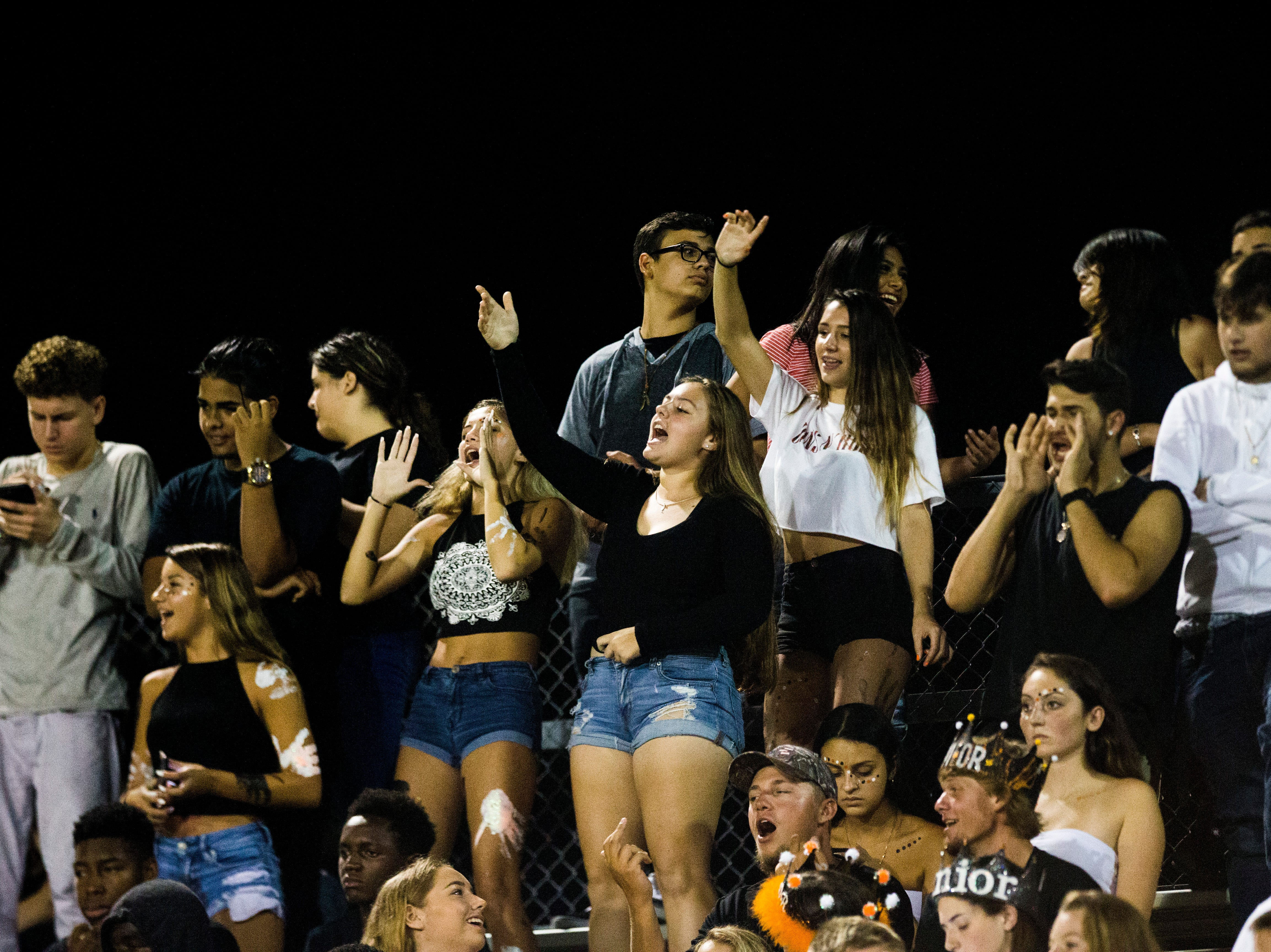 Lely fans cheer during the game against Golden Gate at Lely High School on Friday, Sept. 7, 2018.