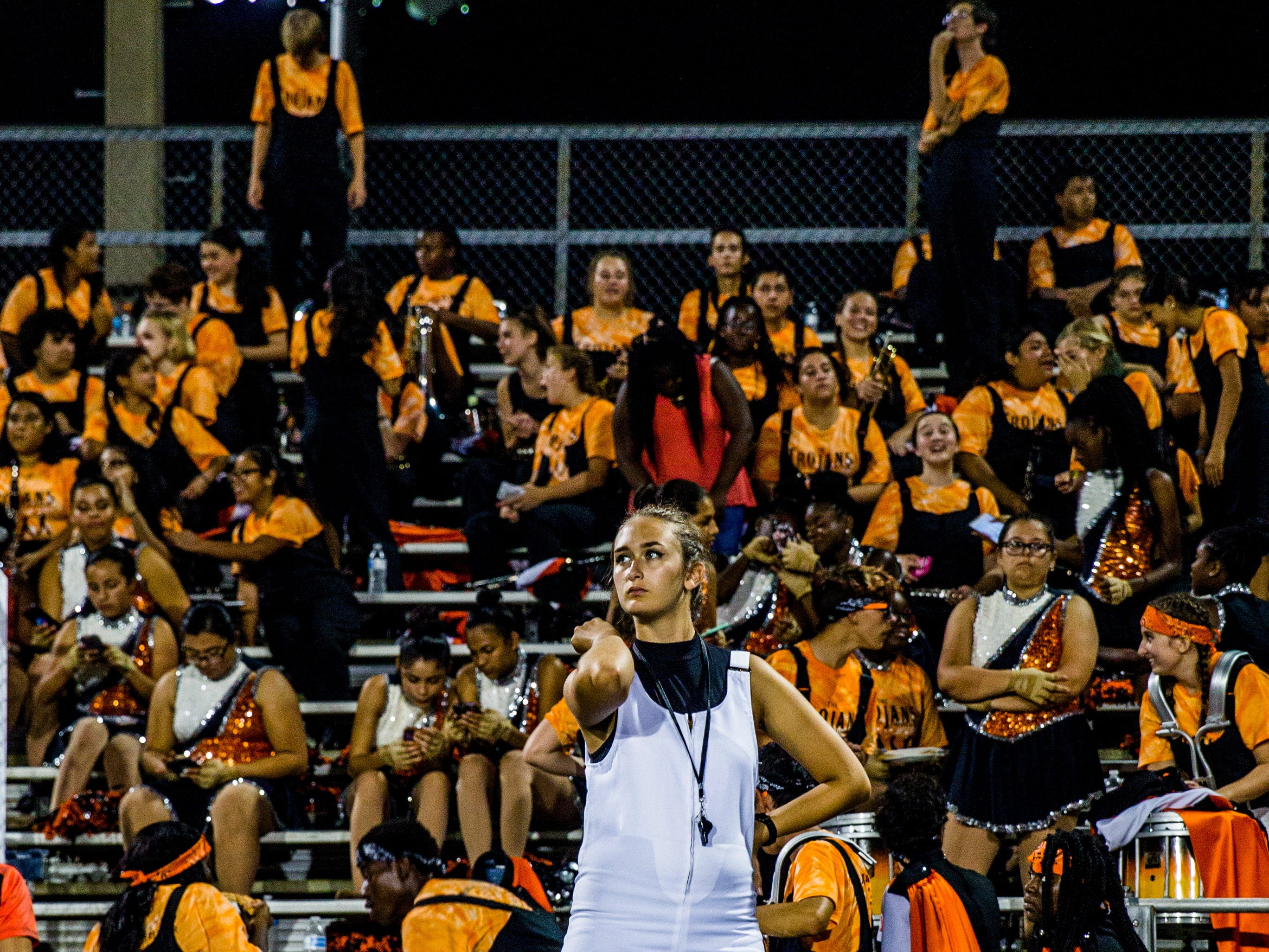Lely band members watch the game against Golden Gate at Lely High School on Friday, Sept. 7, 2018.