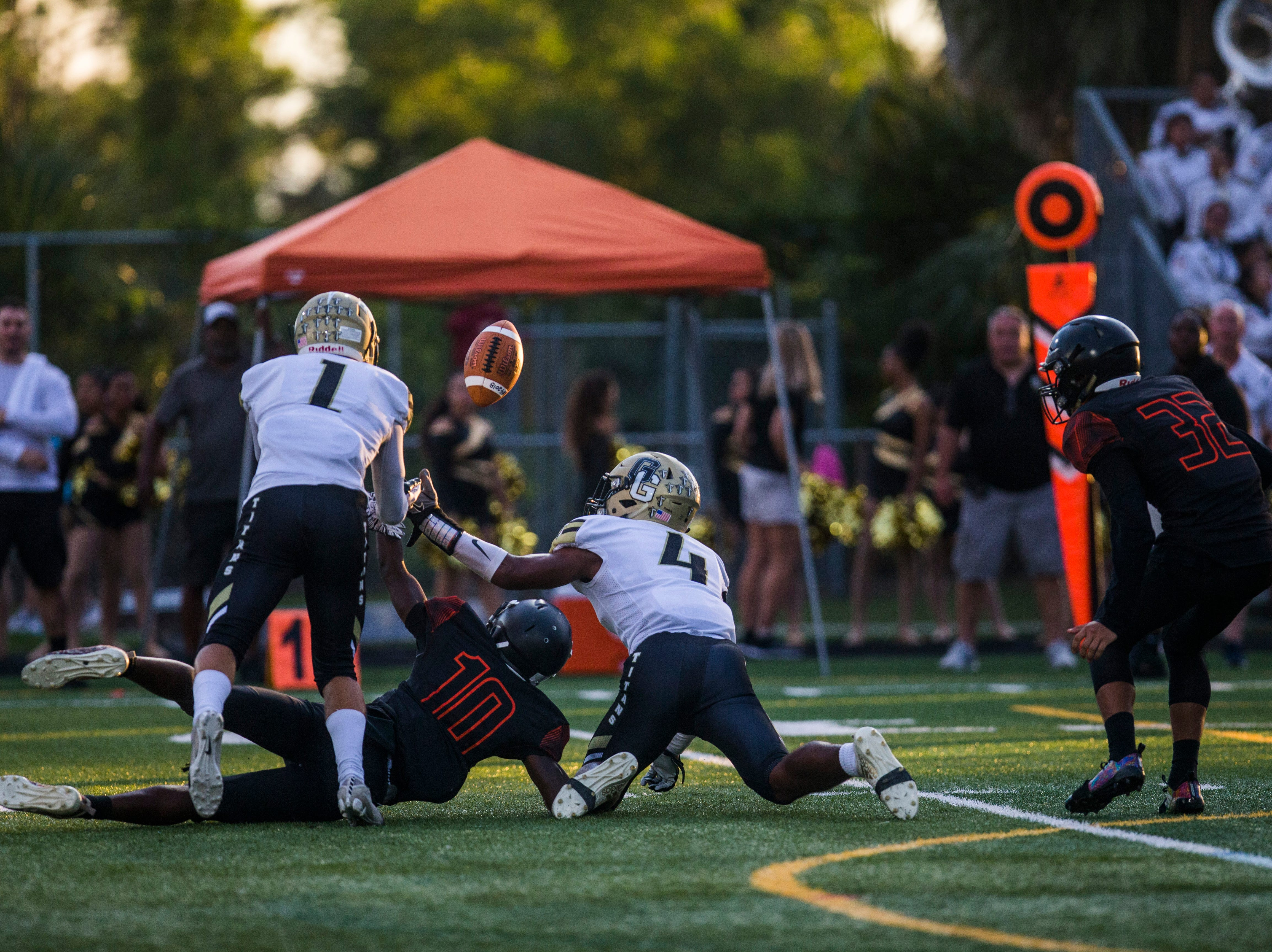 The ball is fumbled during the game between Lely and Golden Gate at Lely High School on Friday, Sept. 7, 2018.