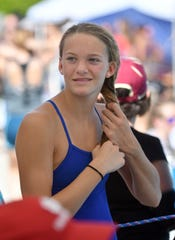 Barron Collier's Madison Feehery, who competed in the Shark Relays at Norris Pool on Saturday, transferred from Community School along with older sister Emma.