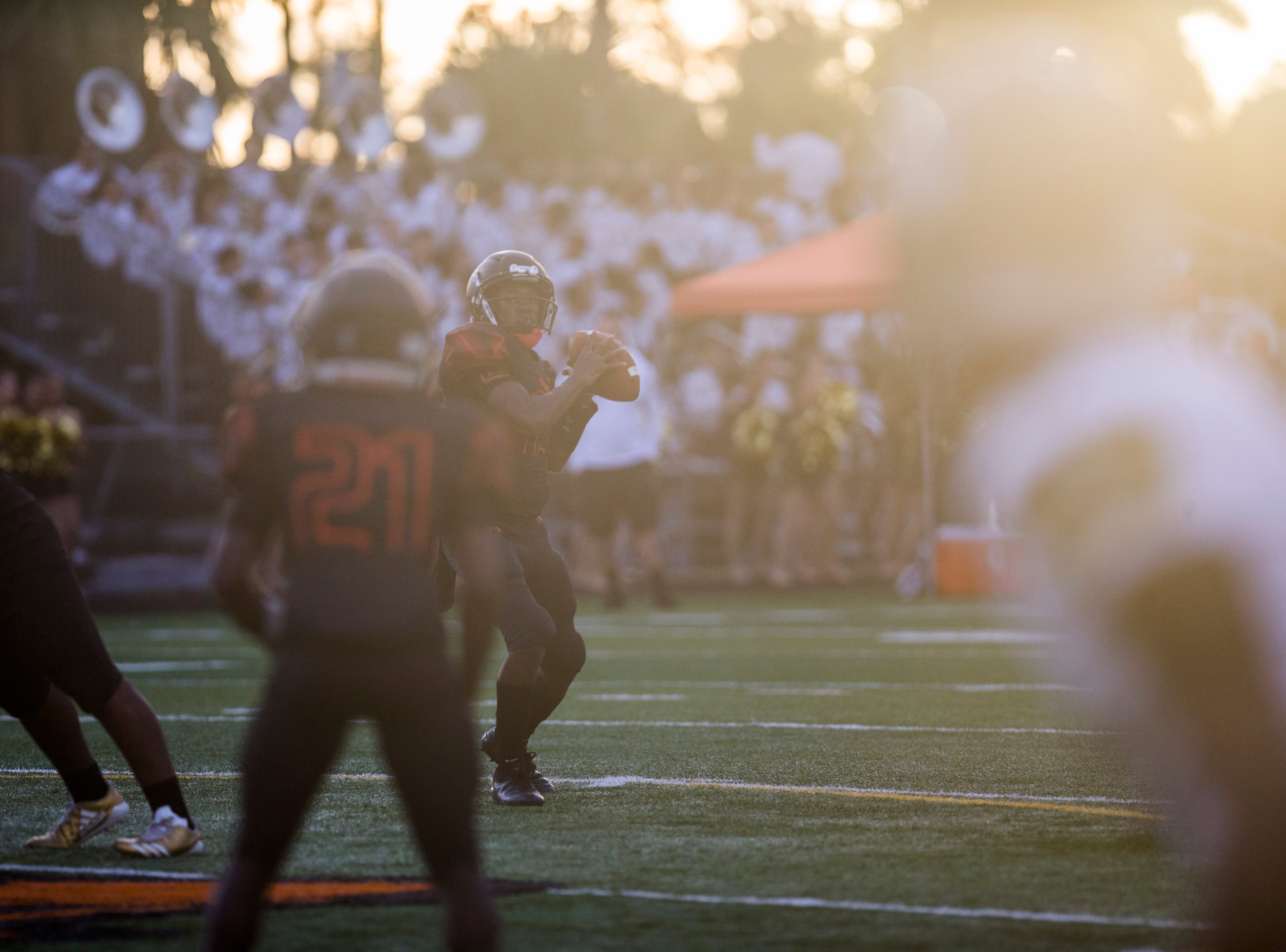 Lely makes a play against Golden Gate at Lely High School on Friday, Sept. 7, 2018.