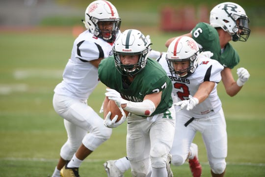 Bergenfield at Ramapo on Friday, September 7, 2018. R #27 Max Baker on his way to scoring a touchdown in the first quarter.