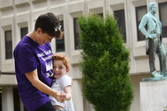 Denise Otto from West Milford dances with her foster son Noah Krieck, five years, old prior to the Passaic County Recovery Walk in Paterson on Saturday September 8, 2018.
