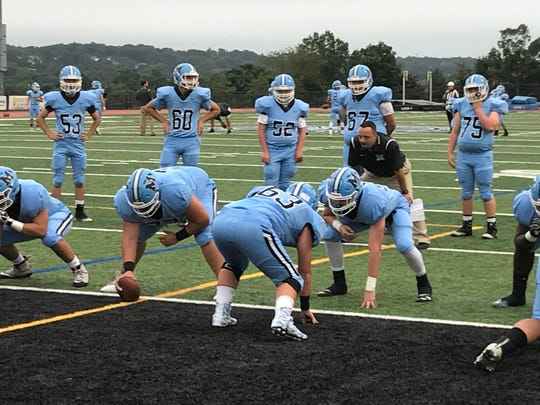 Mahwah football coach Chris Diaz (in black shirt) runs offensive and defensive line warm-ups prior to the Thunderbirds' Friday, Sept. 7, 2018 game versus Paramus.