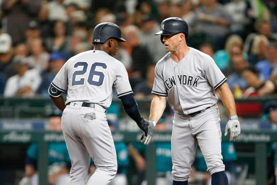Sep 7, 2018; Seattle, WA, USA; New York Yankees right fielder Andrew McCutchen (26) is greeted by left fielder Brett Gardner (11) after hitting a two-run homer against the Seattle Mariners during the third inning at Safeco Field. Gardner scored on the hit.