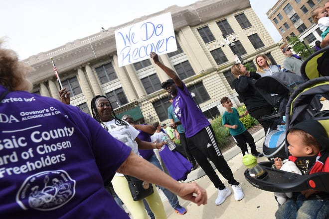 People dance on Hamilton Street prior to the Passaic County Recovery Walk in Paterson on Saturday September 8, 2018.