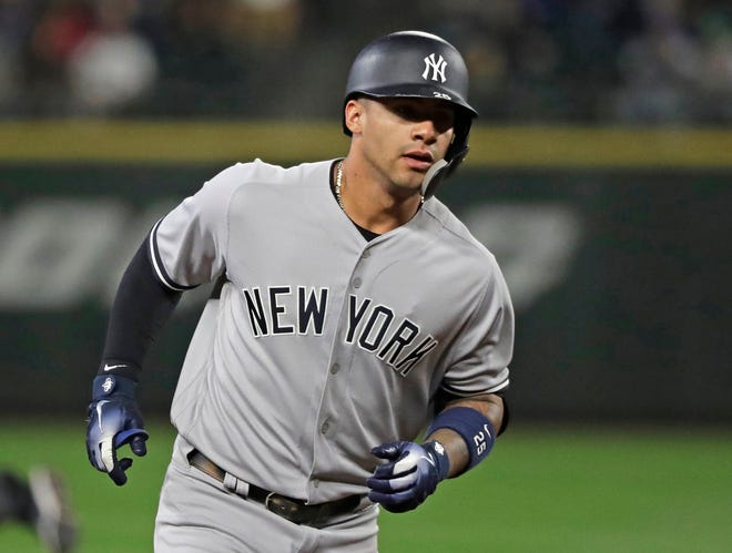 New York Yankees' Gleyber Torres rounds the bases after he hit a two-run home run during the second inning of the team's baseball game against the Seattle Mariners, Friday, Sept. 7, 2018, in Seattle.
