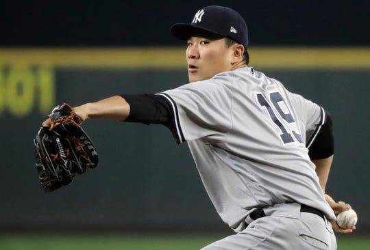 New York Yankees starting pitcher Masahiro Tanaka throws to a Seattle Mariners batter during the fifth inning of a baseball game, Friday, Sept. 7, 2018, in Seattle.