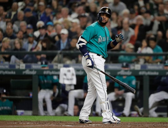 Seattle Mariners' Robinson Cano looks toward the infield after he struck out swinging with a man on base to end the sixth inning of a baseball game against the New York Yankees, Friday, Sept. 7, 2018, in Seattle.