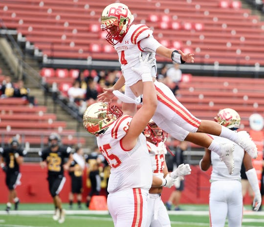Bergen Catholic vs. Archbishop Wood at Rutgers' High Point Solutions Stadium on Saturday, September 8, 2018. BC #4 Andrew Boel celebrates after scoring a touchdown in the second quarter.