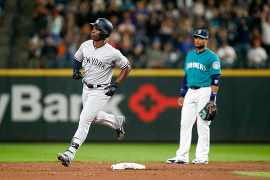 Sep 7, 2018; Seattle, WA, USA; New York Yankees right fielder Andrew McCutchen (26) runs the bases after hitting a two-run homer against the Seattle Mariners during the third inning at Safeco Field.