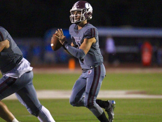 Wayne Hills quarterback Tom Sharkey looks for an open receiver against Wayne Valley.