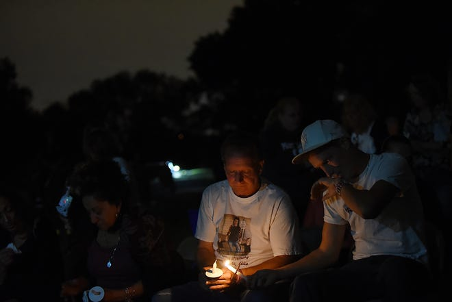Vigil for Shannan Watts and her children in Clifton on Friday September 7, 2018. Watts' father and brother attended the vigil - Frank Rzucek Sr. gets his candle lit by Frankie Rzucek.
