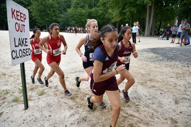 Runners compete in the girls varsity A cross country race at Darlington County Park in Mahwah.