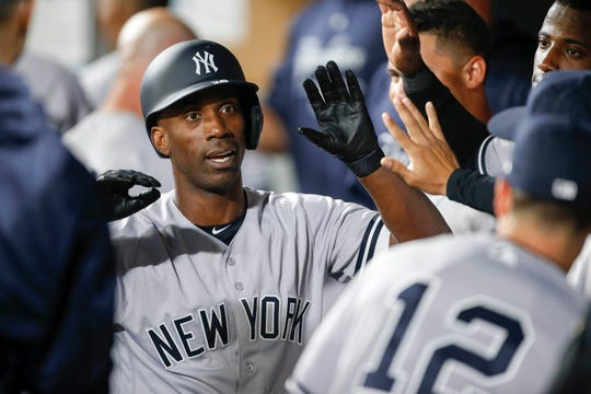 Sep 7, 2018; Seattle, WA, USA; New York Yankees right fielder Andrew McCutchen (26) is greeted in the dugout after hitting a two-run homer against the Seattle Mariners during the third inning at Safeco Field.