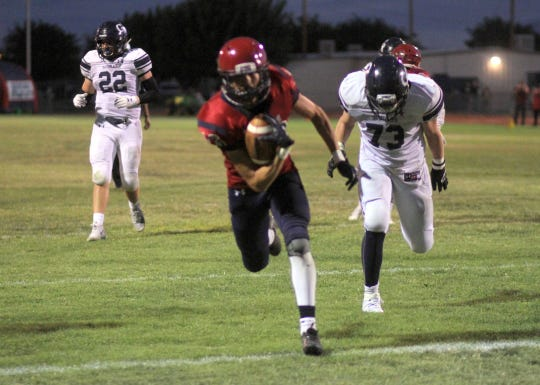 Richard Dozal pulled in a 7-yard TD pass to post Deming's first score of Friday's home game.