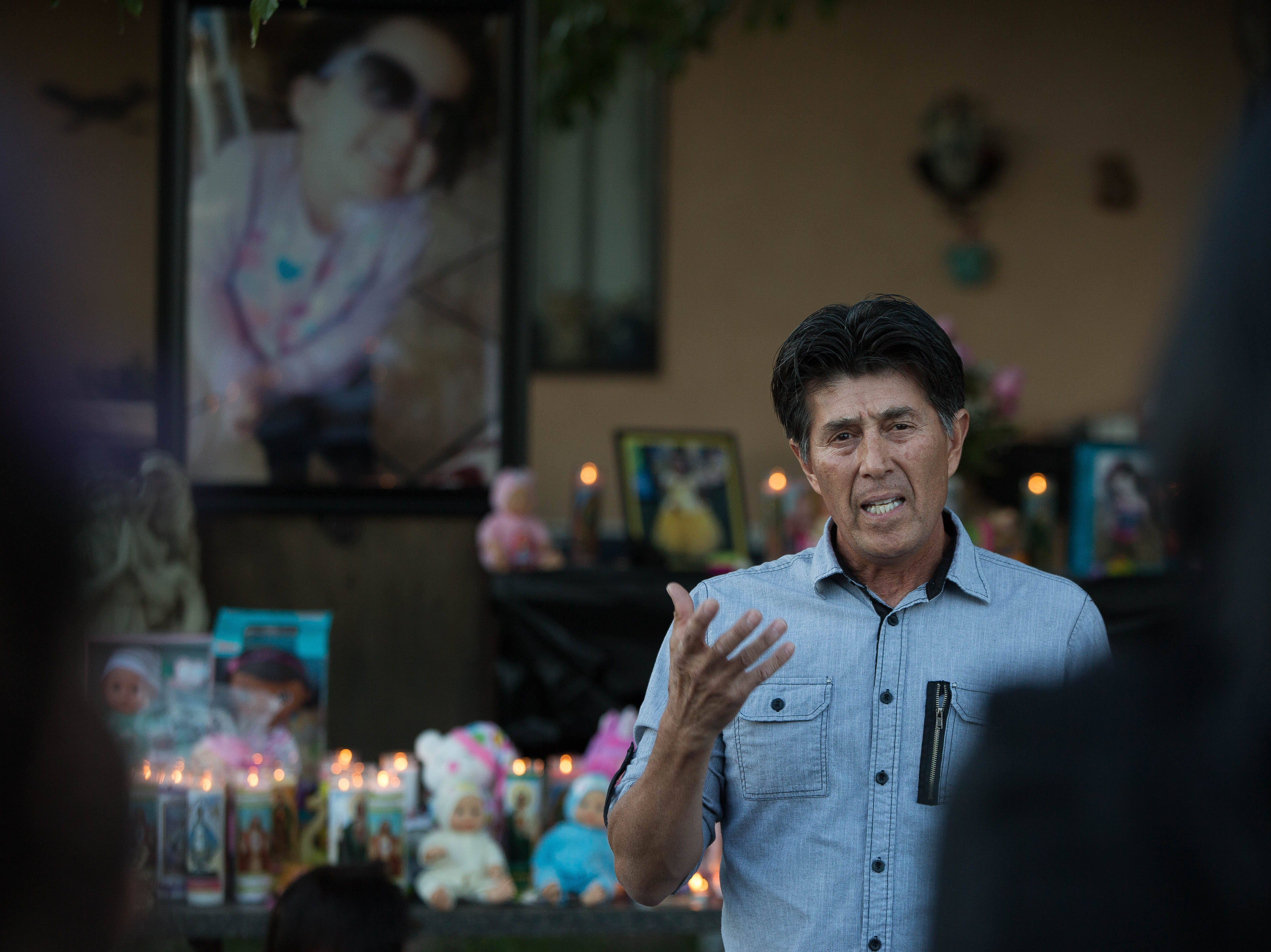 Jerry Acosta, a pastor close family friend of the Gonzales family, lead the friends and family of Fabiola Rodriguez, 2, in a prayer during a candlelight vigil in front of her maternal grandparents home on Poplar Ave. Friday September 7, 2018.