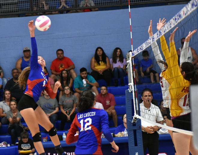 Las Cruces High's Christina Aguayo goes high for a shot during the LCPS  Jane Leupold Sweet 16 volleyball tournament championship game on Saturday afternoon.