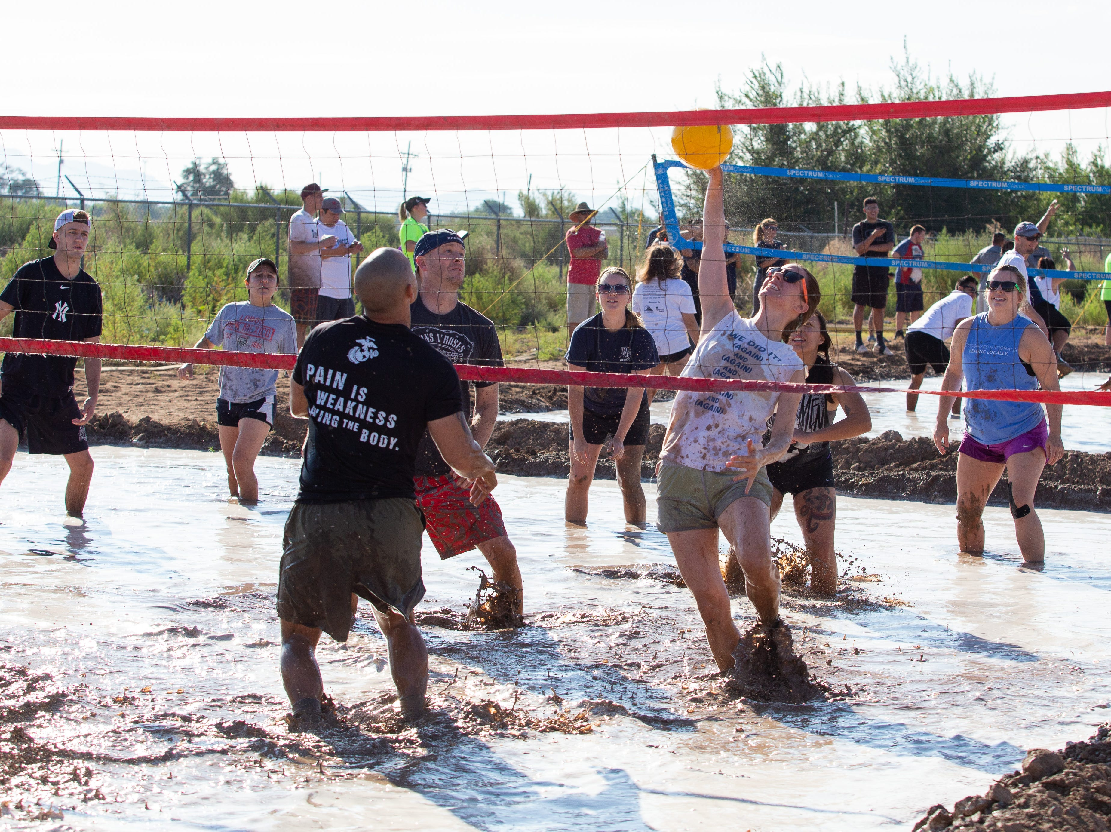 Jackie Geddy of Team Setsy Beasts tips one over the net during the 9th Annual Mudd Volleyball tournament on September 8, 2018.