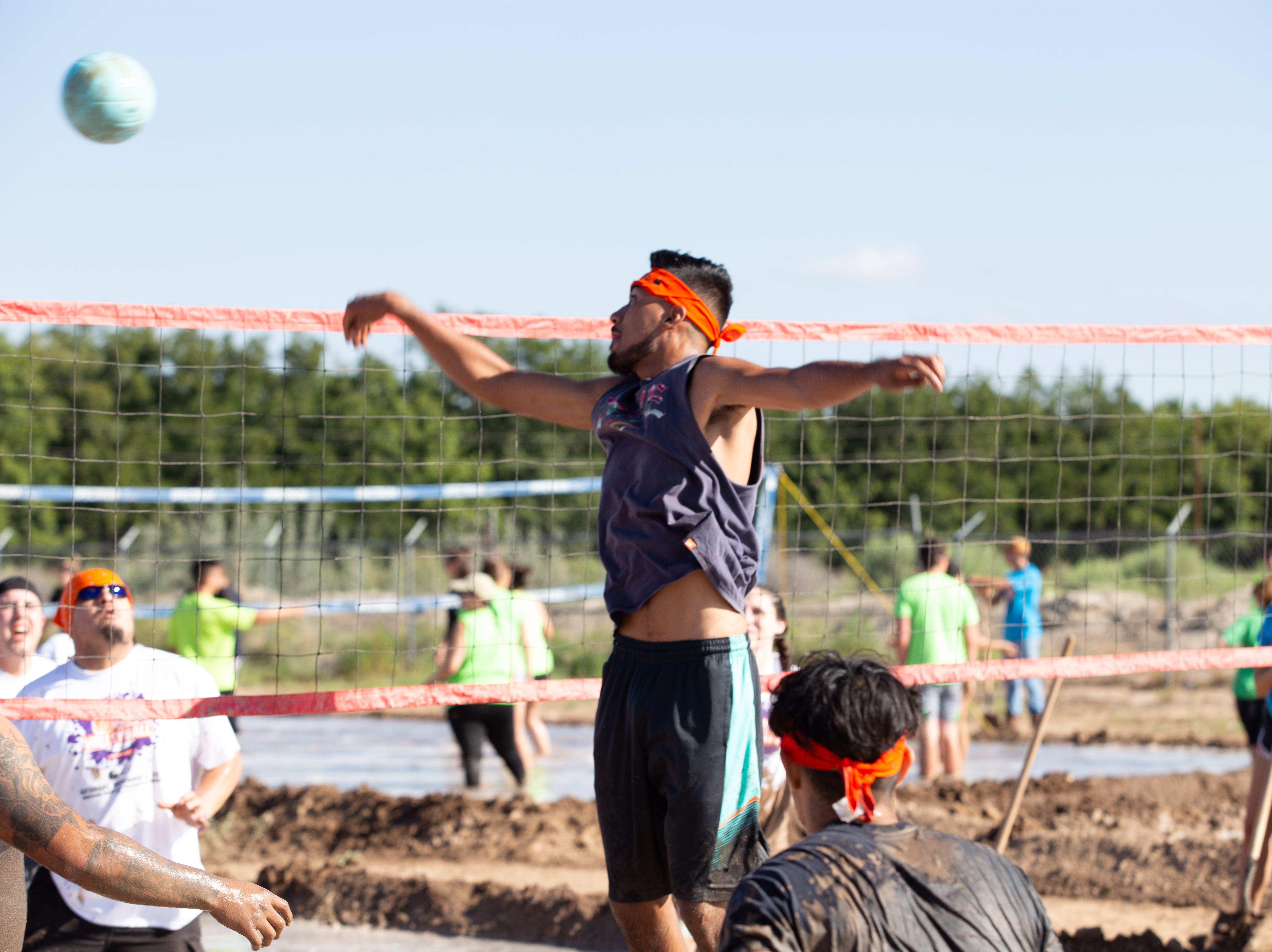 David Castellanos playing for Volley Llamas pops one over the net during the 9th Annual Mudd Volleyball tournament on September 8, 2018.