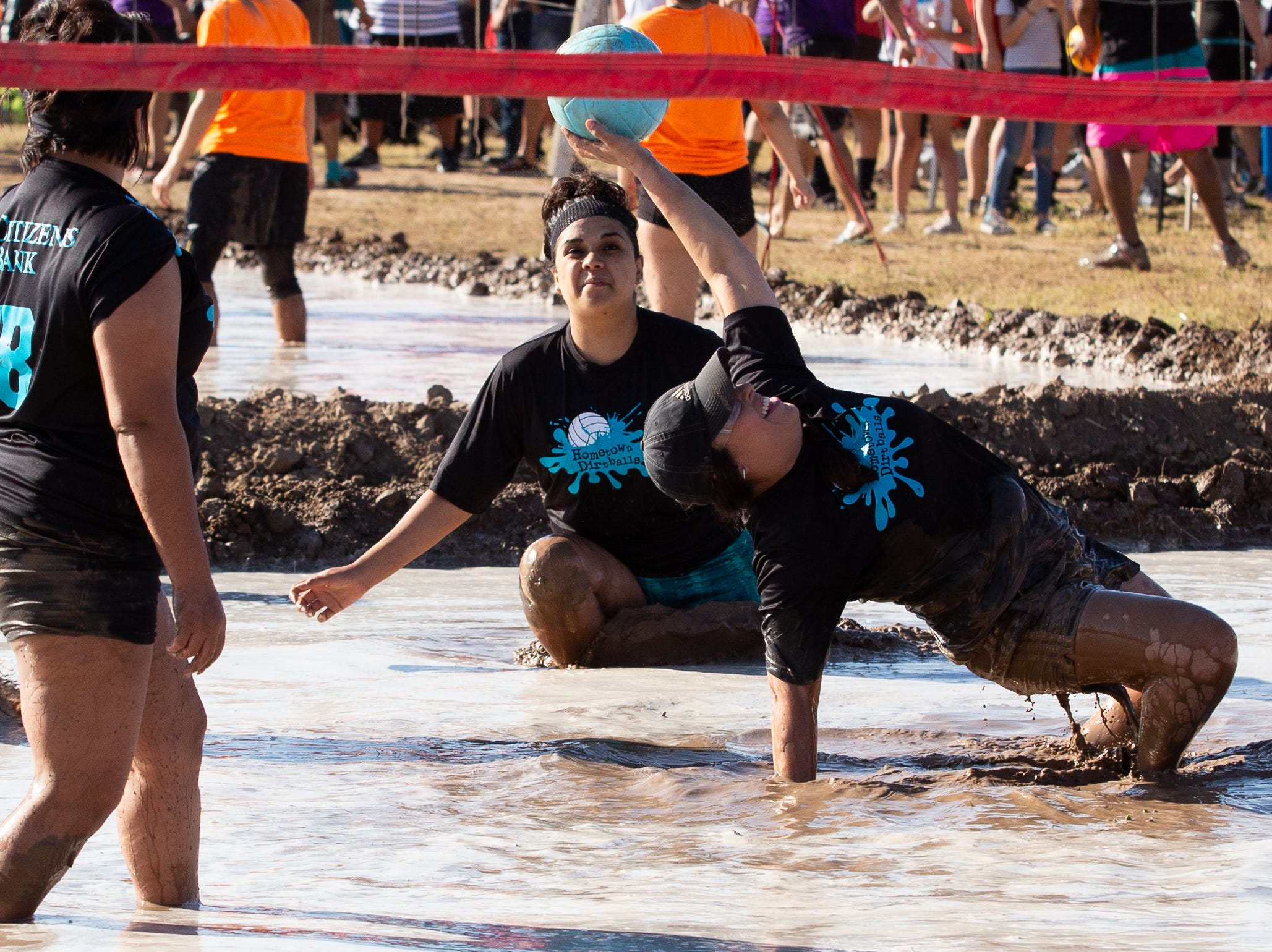 Team Hometown Dirtballs duo of (L) Brenda Martinez and Maria Rodriguez tag team on a save during the 9th Annual Mudd Volleyball tournament on September 8, 2018.