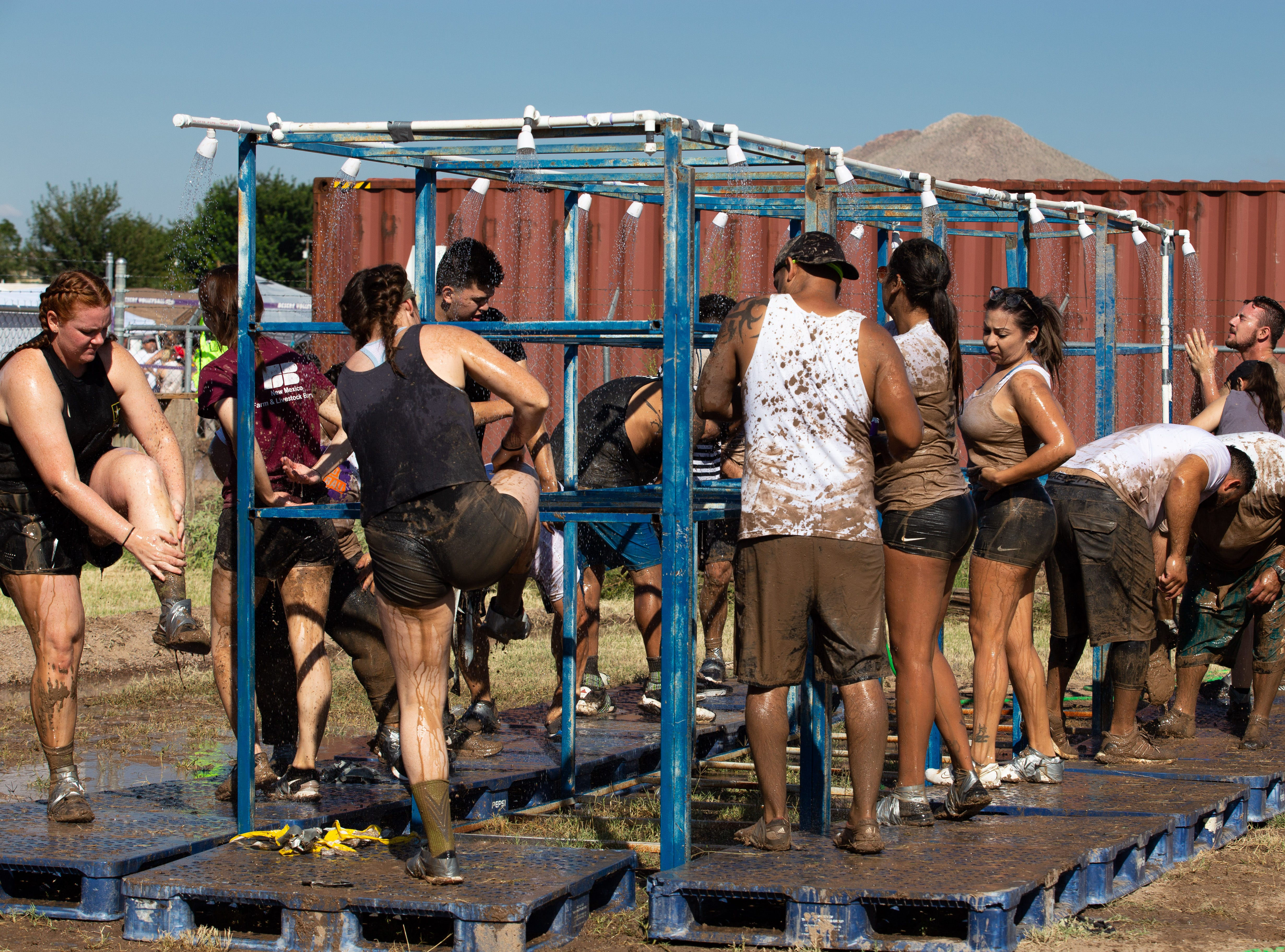A refreshing shower was essential to clean up and cool off at the 9th Annual Mudd Volleyball tournament on September 8, 2018.