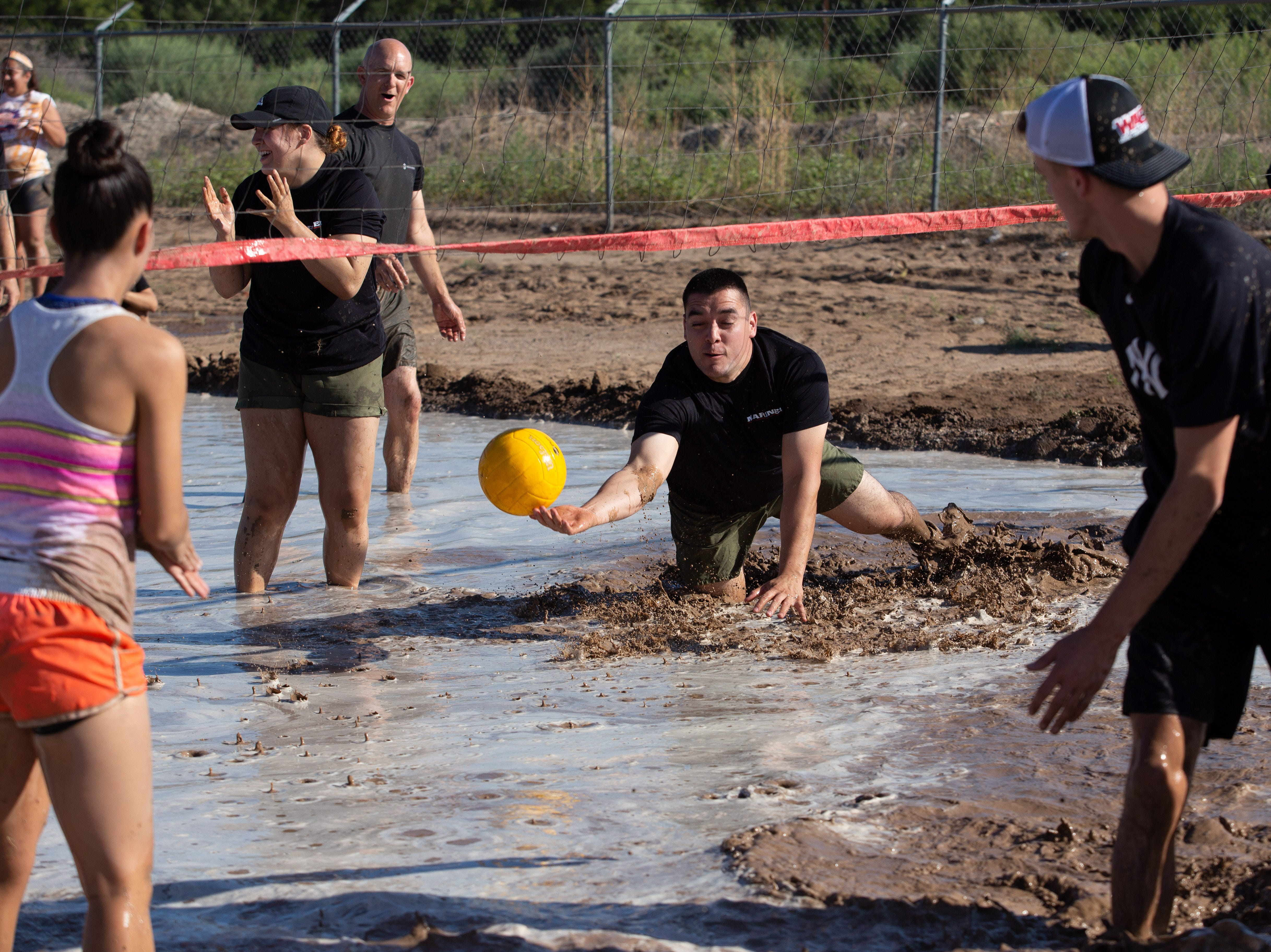 Marine Ruben Madriles takes a dive for the ball during the 9th Annual Mudd Volleyball tournament on September 8, 2018.