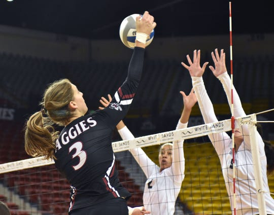 New Mexico State's  Ashley Anselmo goes up for a shot against the University of Arizona on Saturday at the Pan American Center.