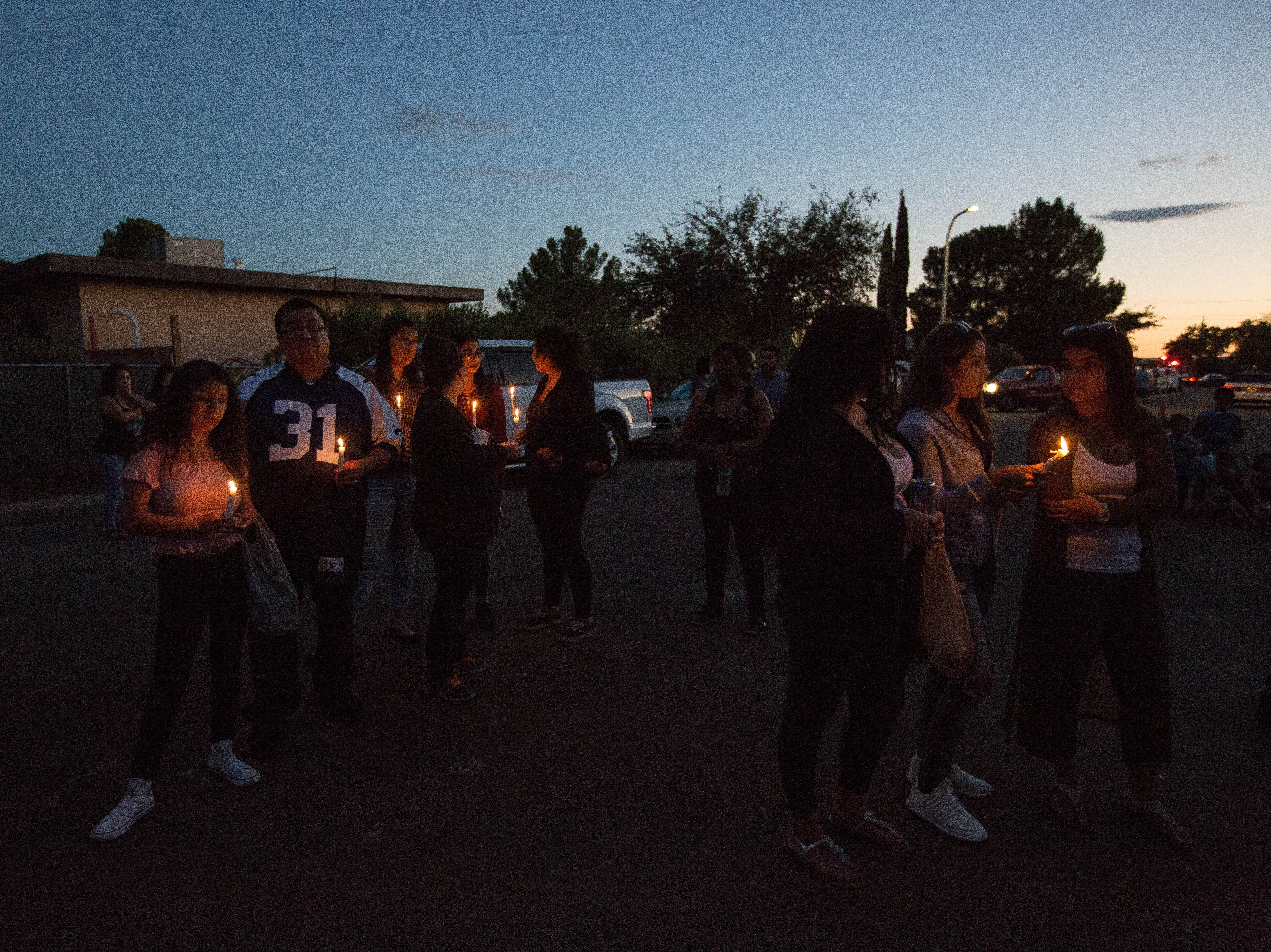 Friends, Members of the Las Cruces Community and Family of Fabiola Rodriguez, 2, gathered outside the house of her maternal grandparents for a candlelight vigil, Friday September 7, 2018.