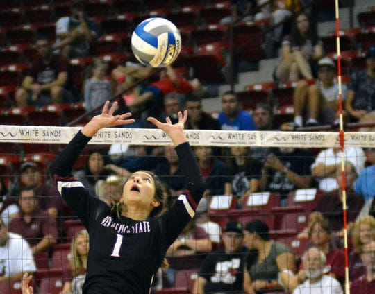 New Mexico State setter Briana Ainsworth looks to set up a teammate on Saturday afternoon against the University of Arizona Wildcats.