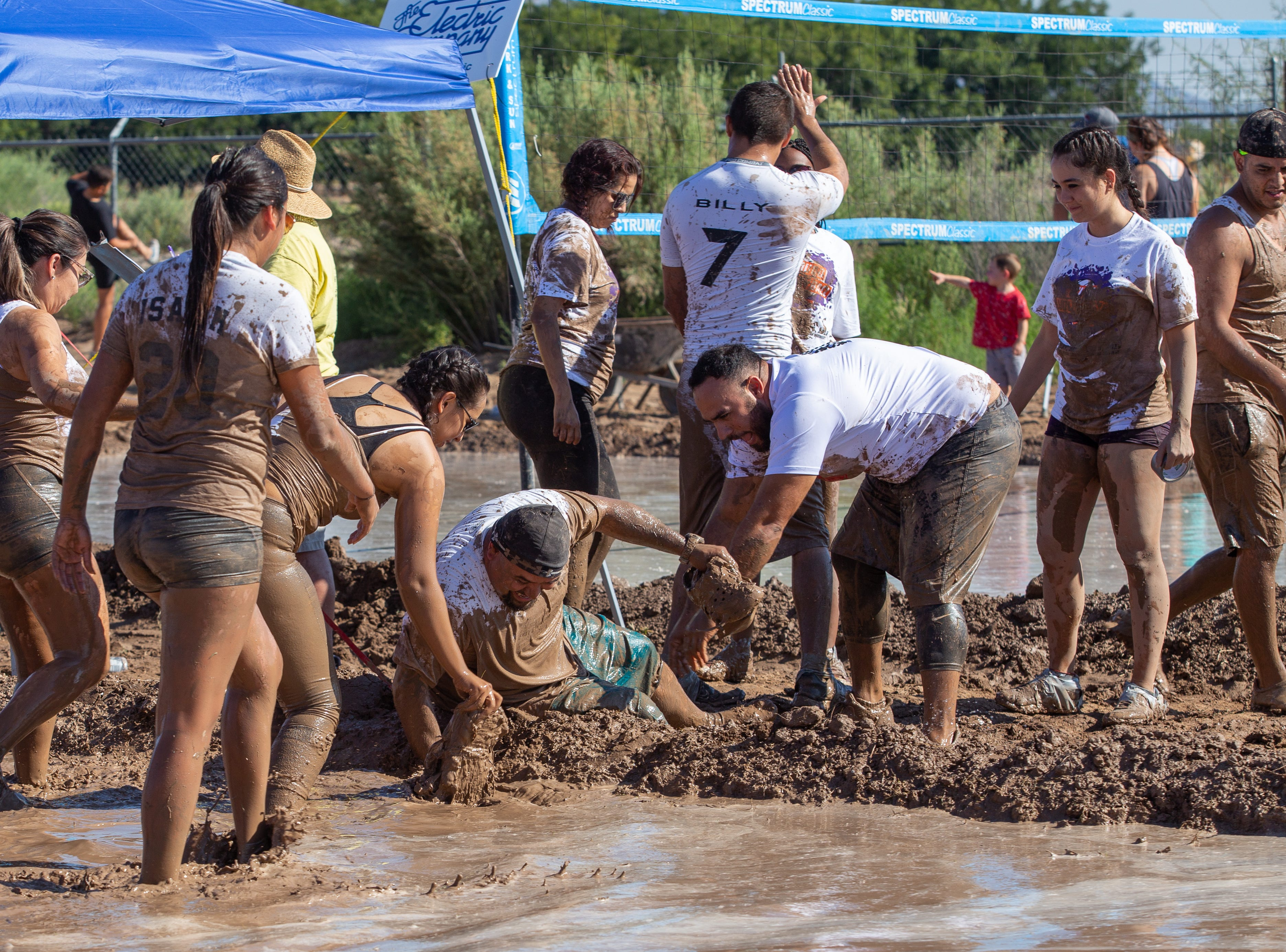 Sticky mud became a problem for Hugo Morales of El Paso Mud Dogs as he loses both his shoes at the 9th Annual Mudd Volleyball tournament on September 8, 2018.