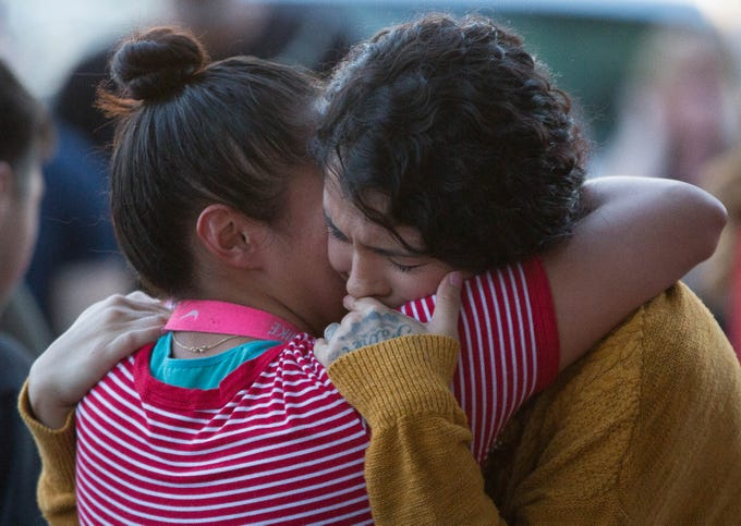 Saundra Gonzales, right, mother of 2 -year-old Fabiola Rodriguez, cries as Ruby Meza, left, hugs her, Friday September 7, 2018 on Poplar Ave, where Rodriguez's maternal grandparents hosted a candlelight vigil.