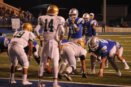 The Cavemen offensive line ahead of a touchdown in the second quarter of the Sep. 7 game against the Atrisco Heritage Jaguars.