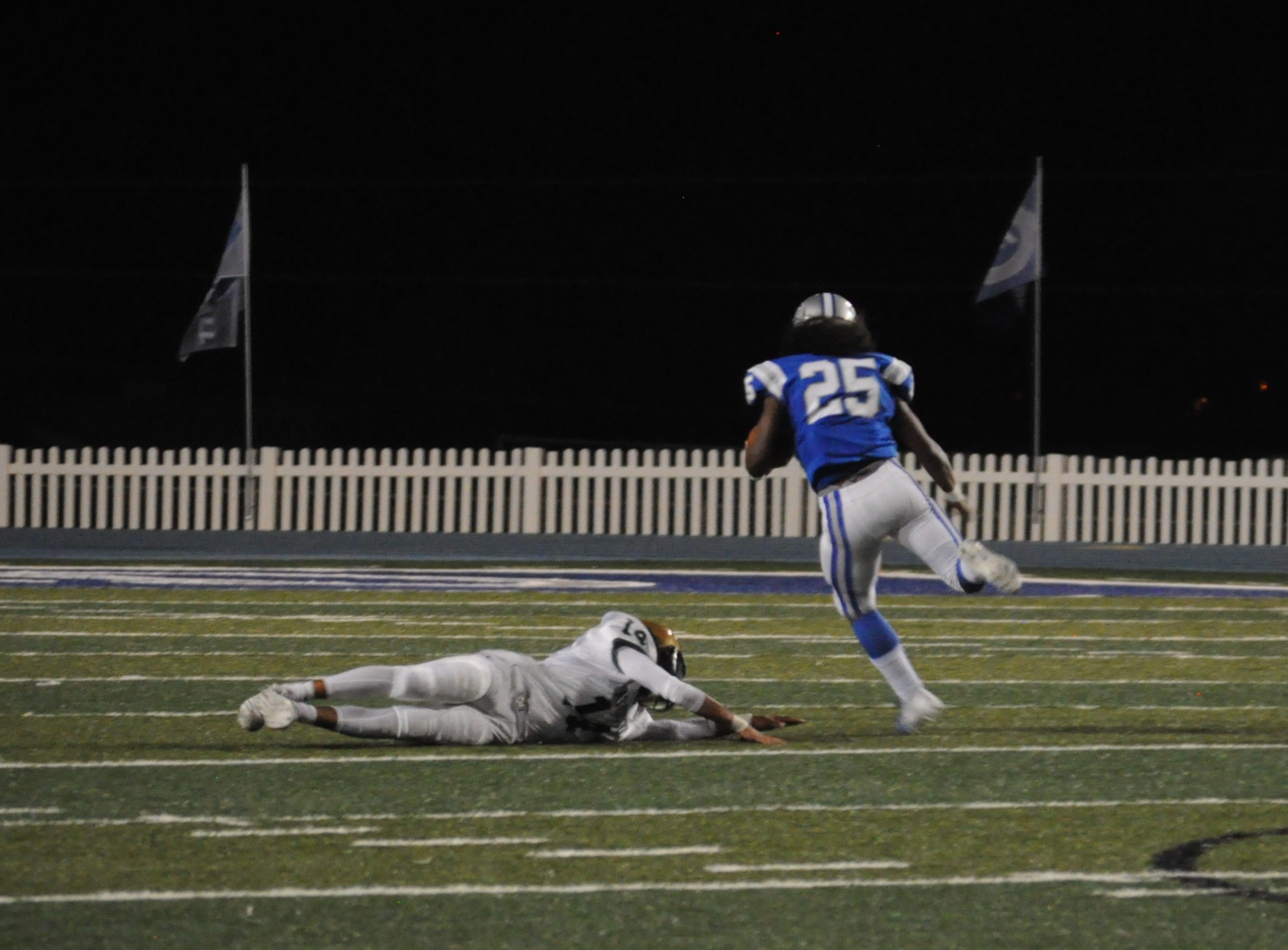 Jonah Matthews avoids a defensive lineman on his way to a touchdown for the Carlsbad Cavemen Sep. 7.