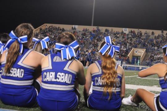 Cavemen cheerleaders take in the halftime show Sep. 7.