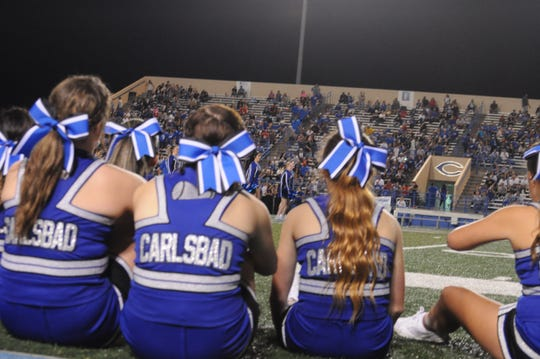 Cavemen cheerleaders take in the halftime show Sep. 7.