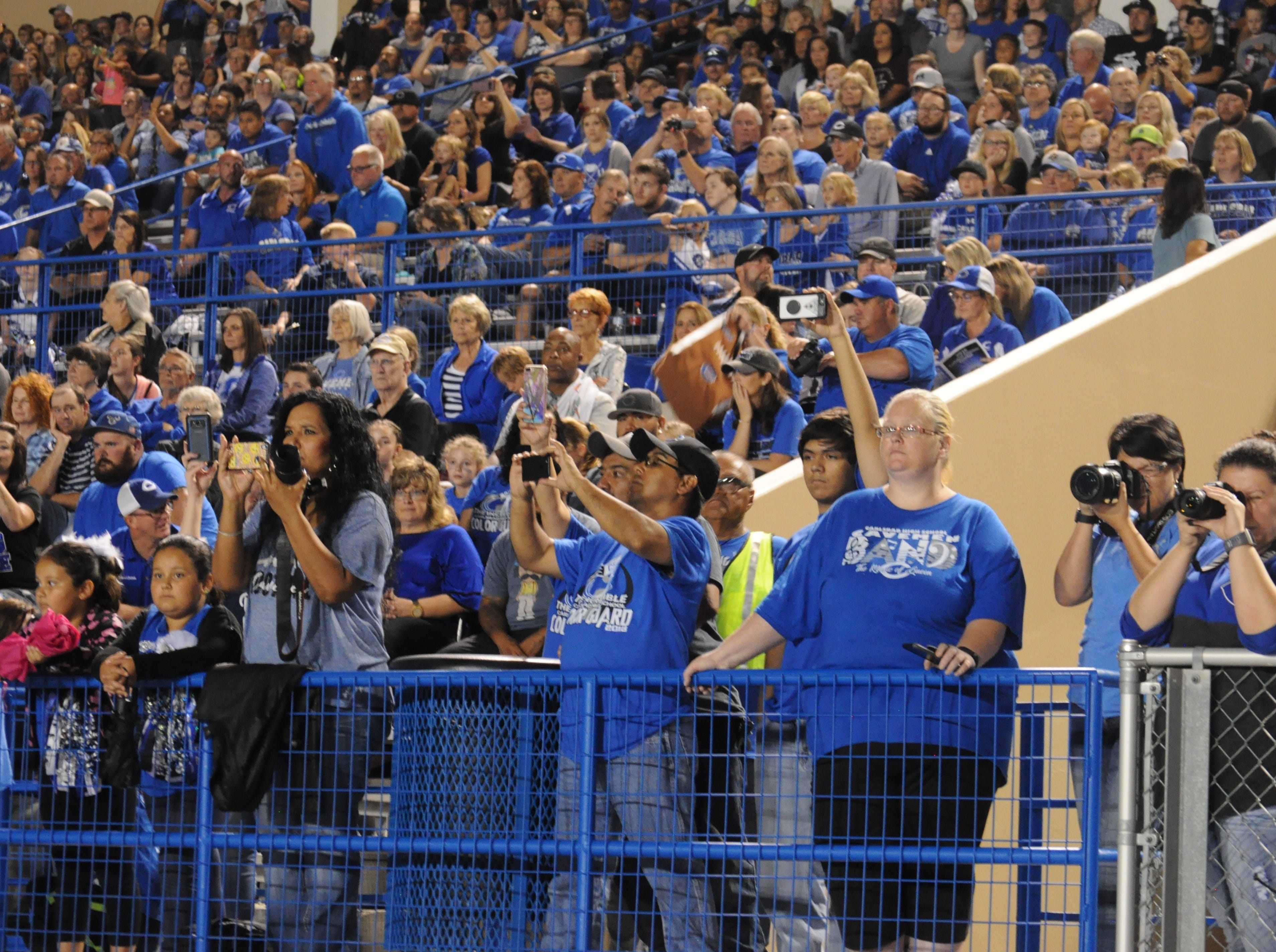 The crowd cheers on the Cavemen Band during halftime of the Carlsbad Homecoming game Sep. 7.