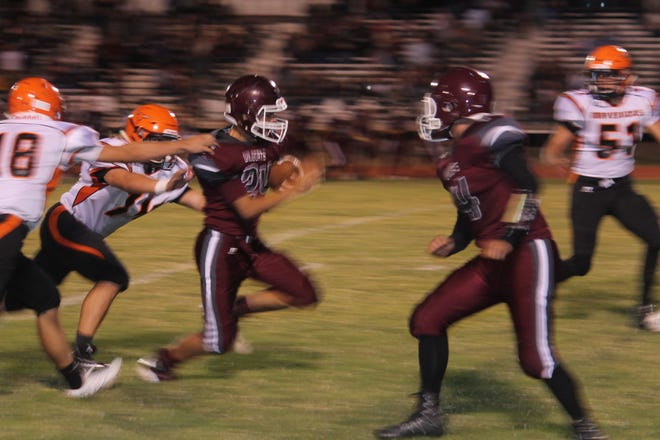 Tularosa senior #24 Anthony Betancur breezes through Lordsburg defenses in their match-up on Sept. 7.