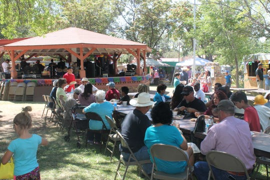 Hundreds gather in Presidio Park in La Luz for the 2018 Fiesta de La Luz, held each year as a fundraiser for the Our Lady of the Light Catholic Church.
