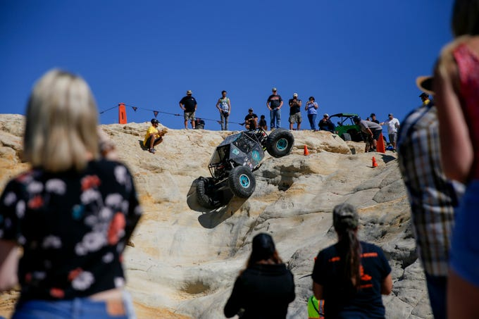 Spectators watch as Virgil Ray,Tonopah, Arizona navigates up a rock face, Saturday, Sept. 8, 2018 during the W.E. Rock Grand Nationals at the Brown Spring Campground rock crawl in Glade Run north of Farmington.