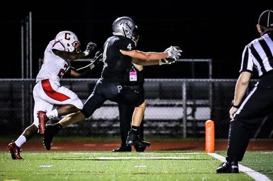 Plymouth's Nathan Janke (4) scores on a 79-yard kick-off return for a TD in Friday's 47-26 loss to Canton.