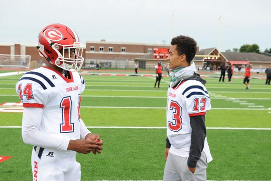 Dominic Spalding (right) and teammate Marco Delisio (14) chat before the game at Churchill.
