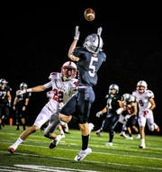 Plymouth's Jeremy Fuchs (5) goes up for the catch against Canton defender Tyler Milo.