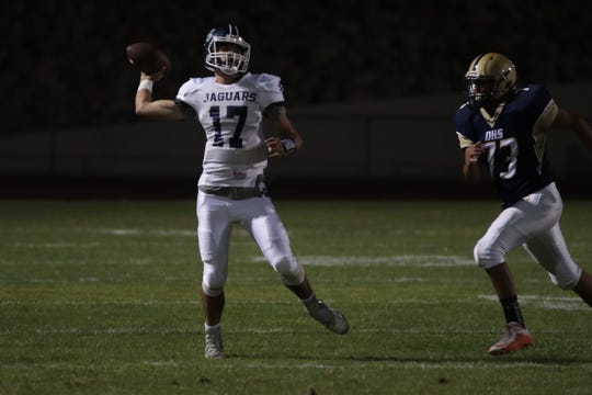 Benjamin Miramontes looks for a pass at Desert Hot Springs High School, Friday, September 6, 2018.