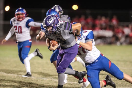 Shadow Hills' Hunter Brooks carries the ball in the first quarter against Indio on Friday, September 7, 2018 at Shadow Hills High School in Indio.