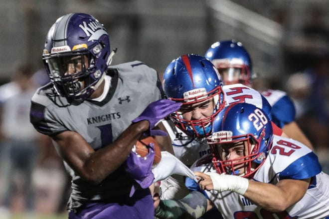 Shadow Hills' Kevin Johnson carries the ball for a touchdown in the first quarter against Indio on Friday, September 7, 2018 at Shadow Hills High School in Indio.