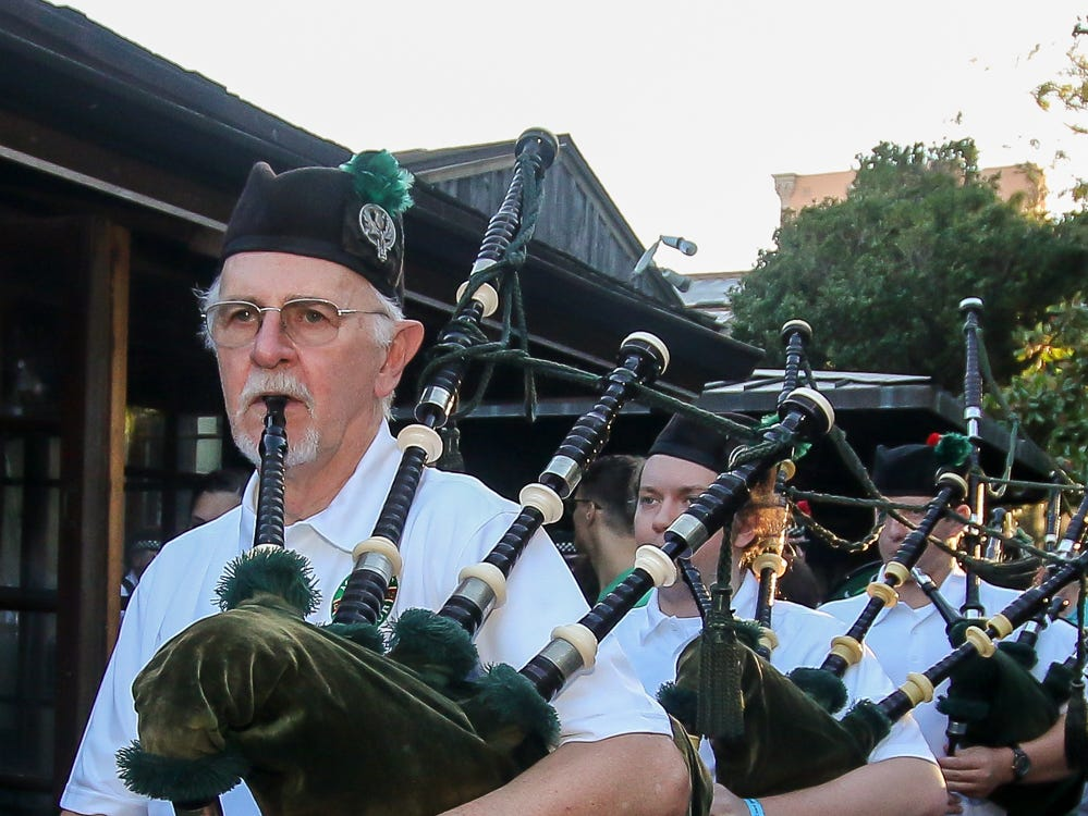 The McGuire's Pipe Band makes its way through Seville Quarter during the 23rd annual Emerald Coast Beer Festival Friday, September 7, 2018. The event helps raise money for the Alfred-Washburn Center and Seville Rotary Club.